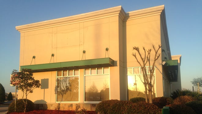 Signs have been removed from the Krispy Kreme store on Youree Drive in Shreveport, which closed for business Sunday.