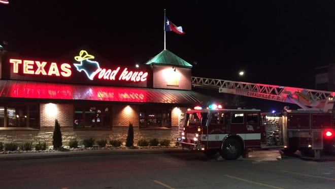 The Coralville Fire Department battles a fire that spread to the ductwork at Texas Roadhouse on Corridor Way on Monday.