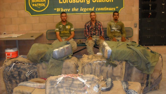 U.S. Border Patrol agents from the Lordsburg station apprehended four men, including the three pictured here, carrying backpacks filled with marijuana in the New Mexico bootheel area on Aug. 25.