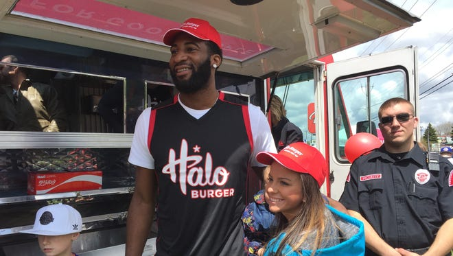 Pistons center Andre Drummond poses for photographs with fans at an event in Fenton to celebrate the launch of his signature burger at Halo Burger on Saturday, May 6, 2017.