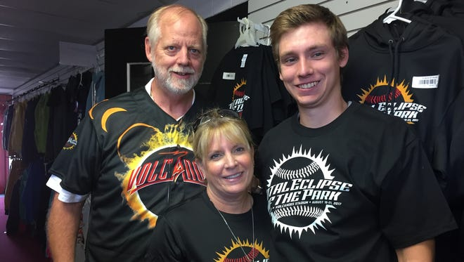 Volcanoes co-owners Jerry and Lisa Walker, with their son Mickey, donning Eclipse Game attire available in the Volcanoes team shop.