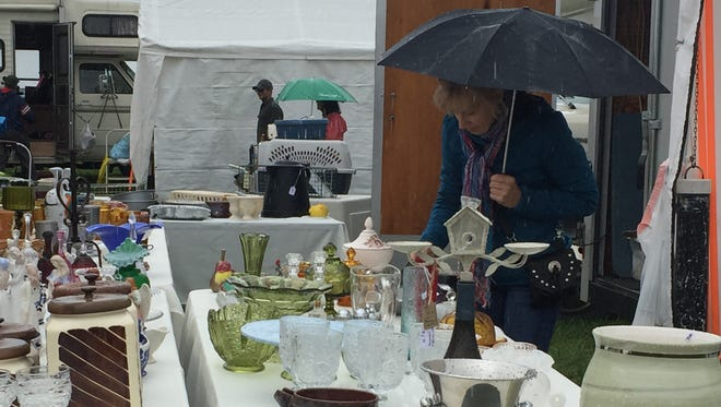 A 2017 Advocate file photo shows a woman looking at items for sale at the 73rd annual Swappers Day. The event is organized by the Johnstown Community Sportsman's Club and was cancelled for 2020 due to the coronavirus pandemic.