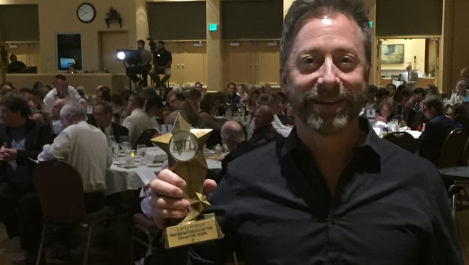 Larry Raben holds his Desert Star Award for Outstanding Director of a professional drama at Sunday's Desert Theatre League awards ceremony in Palm Desert.