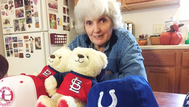 Annie Fassnacht branched out from sending Teddy bears to the troops to sending team-logo caps donated from the NFL, MLB and NBA.