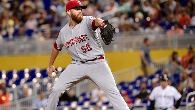 Cincinnati Reds starting pitcher Dan Straily (58) throws during the first inning against the Miami Marlins at Marlins Park.