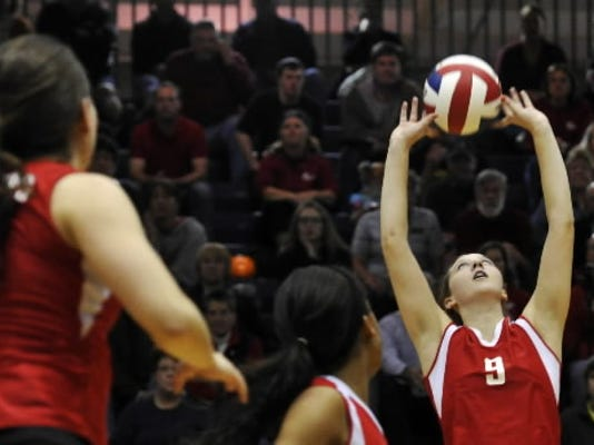 Susquehannock's Abigail Bentz sets the ball in the first match of a District 3-AAA girls' volleyball semifinal against Cumberland Valley. Bentz, a junior, was voted to the PVCA district all-star team. (Chris Dunn - Daily Record/Sunday News)