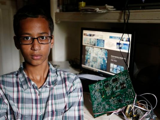 Irving MacArthur High School student Ahmed Mohamed, 14, poses for a photo at his home in Irving, Texas on Tuesday, Sept. 15, 2015. Mohamed was arrested and interrogated by Irving Police officers on Monday after bringing a homemade clock to school. Police don't believe the device is dangerous, but say it could be mistaken for a fake explosive. He was suspended from school for three days, but he has not been charged.