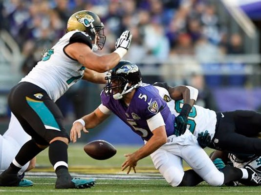 Baltimore Ravens quarterback Joe Flacco (5) fumbles the ball in the second half against the Jacksonville Jaguars on Sunday in Baltimore. Jacksonville recovered the ball on the play and went on to win 22-20.