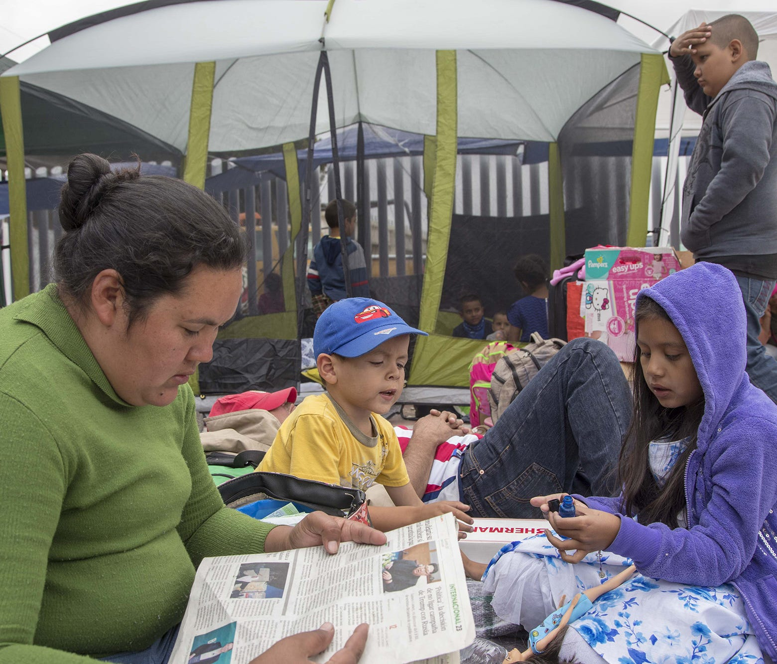About 200 migrants from Central America who traveled in a caravan through Mexico were camped outside the entrance of the San Ysidro, Calif., port of entry, Monday, April 30, 2018, after being turned away Sunday, April 29, 2018, by U.S. Customs and Bo