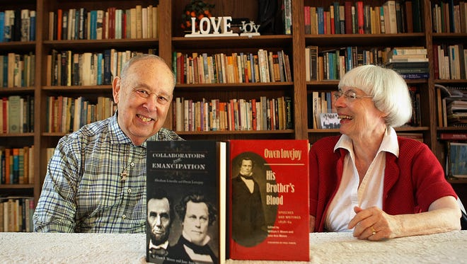"""Authors and former ministers William and Jane Moore of DeKalb, Ill.,  are shown with the two books they authored about Owen Lovejoy. Their latest book """"Collaborator for Emancipation: Abraham Lincoln and Owen Lovejoy,"""" chronicles the two men's friendship and working relationship to stop the spread of slavery."""