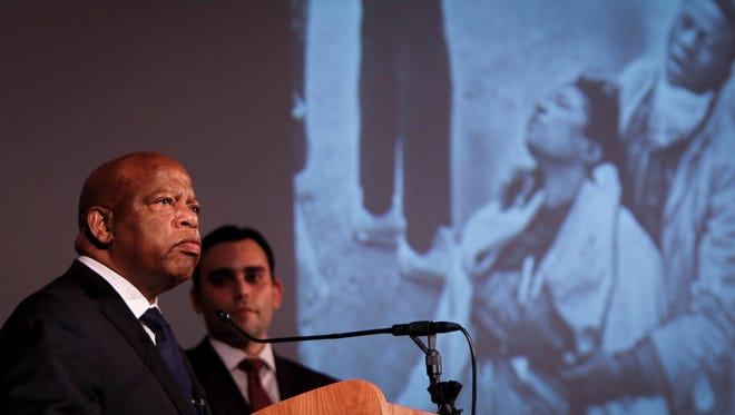 """Civil rights hero and co-author of """"March Book One"""" Congressman John Lewis speaks Monday, August 25, 2014, at the Hannah Community Center in East Lansing.  Flanking him is co-author Andrew Aydin.  Lewis was in East Lansing as part of """"Three Voices on Race in America, part of MSU's Project 60 50, a year-long community conversation on civil and human rights."""