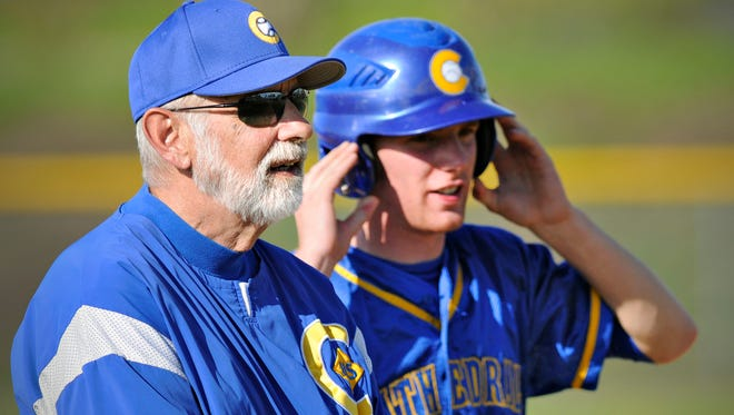 Cathedral's head coach Bob Karn talks with Josh Thyen at third base while Mora changes pitchers in the second inning in St. Joseph Tuesday, May 20. Karn got his 700th win with the teams victory over Mora.
