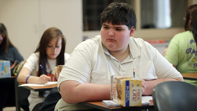 Eric Ekis, a freshman at Franklin Community High School in Franklin, Ind., and other students learn how to read the nutrition labels on packaged food. The response to Eric's weight-loss struggles has been overwhelmingly positive.