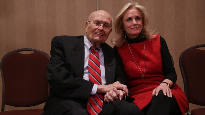 Rep. John Dingell, 87, and his wife Debbie Dingell pose for a photo Monday, Feb. 24, 2014, after a luncheon in Southgate, Mich., where Dingell announced he would retire from Congress. Debbie Dingell is the early favorite to replace her husband.