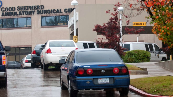 Longview Police Department detective units and two physical evidence section vans sit outside Good Shepherd Ambulatory Surgical Center after a stabbing Tuesday.