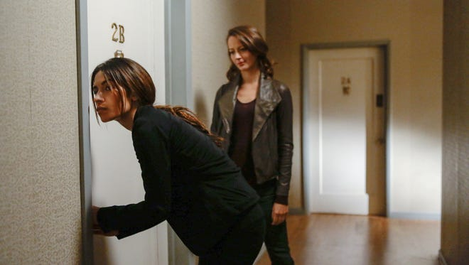 There is a distinct love-hate vibe between new 'Person of Interest' characters Shaw (Sarah Shahi, left) and Root (Amy Acker).