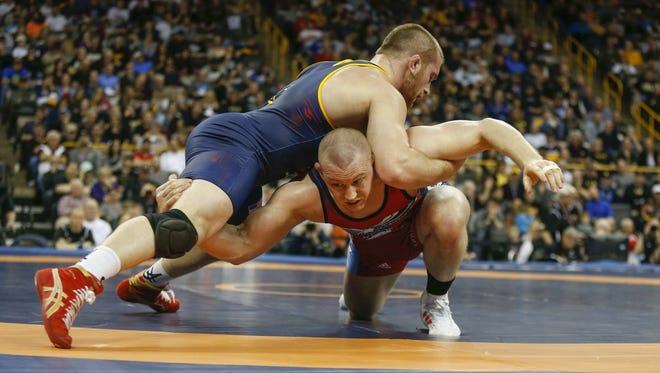 Jake Varner shoots in on Kyle Snyder in their match at 97 KG on Sunday, April 10, 2016, during the wrestling Olympic Trials at Carver-Hawkeye Arena in Iowa City, Iowa.