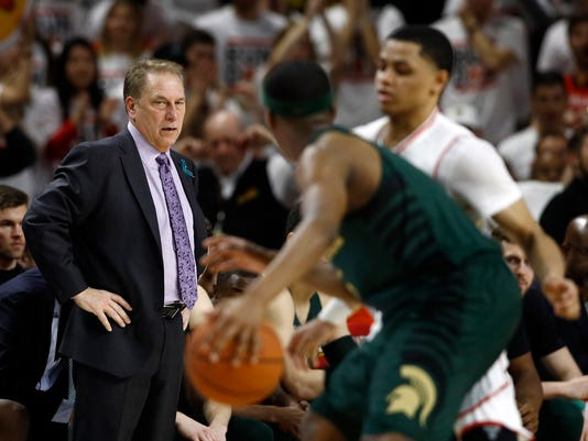 Michigan State head coach Tom Izzo, left, watches the second half of an NCAA college basketball game against Maryland in College Park, Md., Sunday, Jan. 28, 2018. (AP Photo/Patrick Semansky)