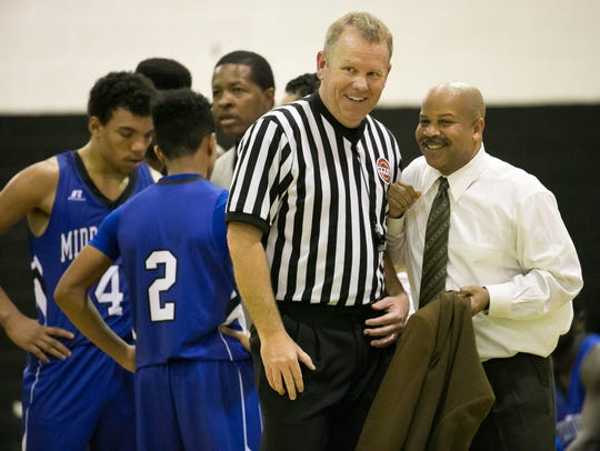 A smiling Middletown coach chats with the referee as
