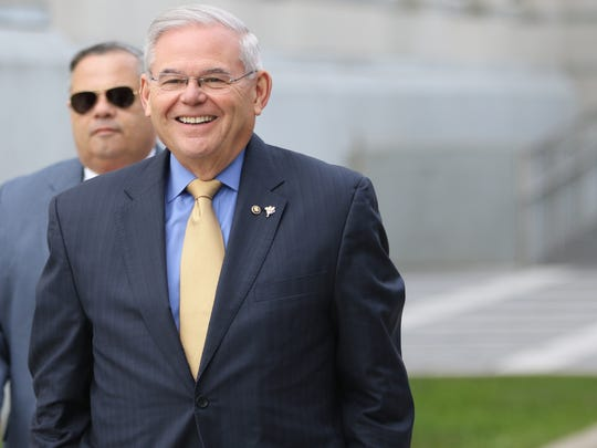 U.S. Sen. Bob Menendez walks away from the federal