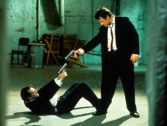 Mr. Pink (Steve Buscemi, left) and Mr. White (Harvey