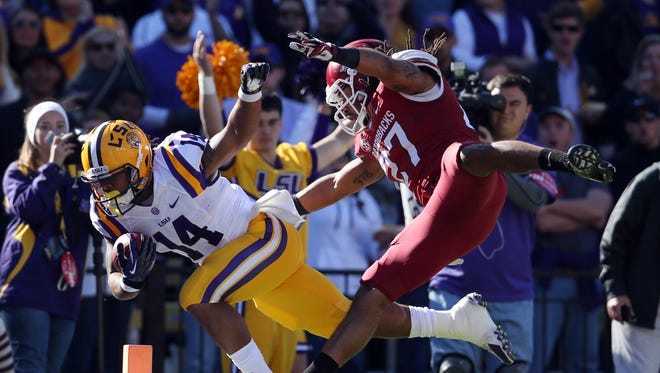 LSU's Terrence Magee drives for a touchdown past Arkansas safety Alan Turner.