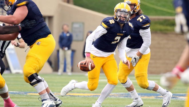 Trey Heid of Augustana scrambles from the pocket during Saturday's game against Winona State in Sioux Falls.