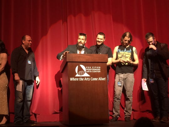Red Light Saints accept the WAMI Award for Hard Rock/Metal