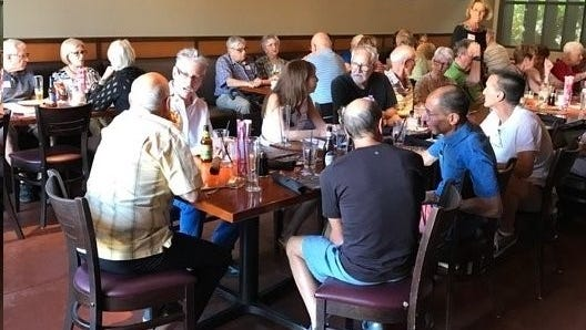 People socialize at a monthly gathering of the Dementia-Friendly Cafe.