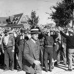 Walter Kohler enters the grounds of the Kohler Company during the 1934 Kohler strike.  Sheboygan Press file photo