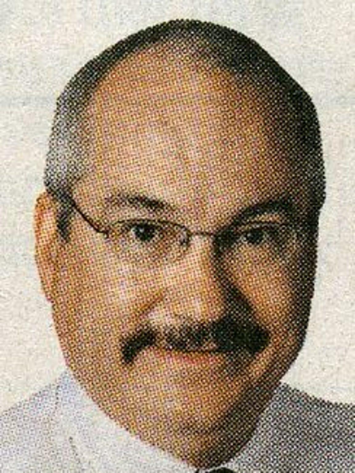 Dr. Charles Szyman