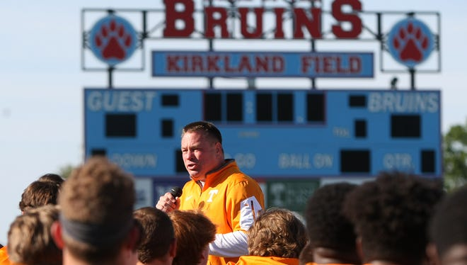 University of Tennessee head coach Butch Jones addresses the players gathered for the lineman camp at University School of Jackson's Kirkland Field on Wednesday, June 8, 2016.