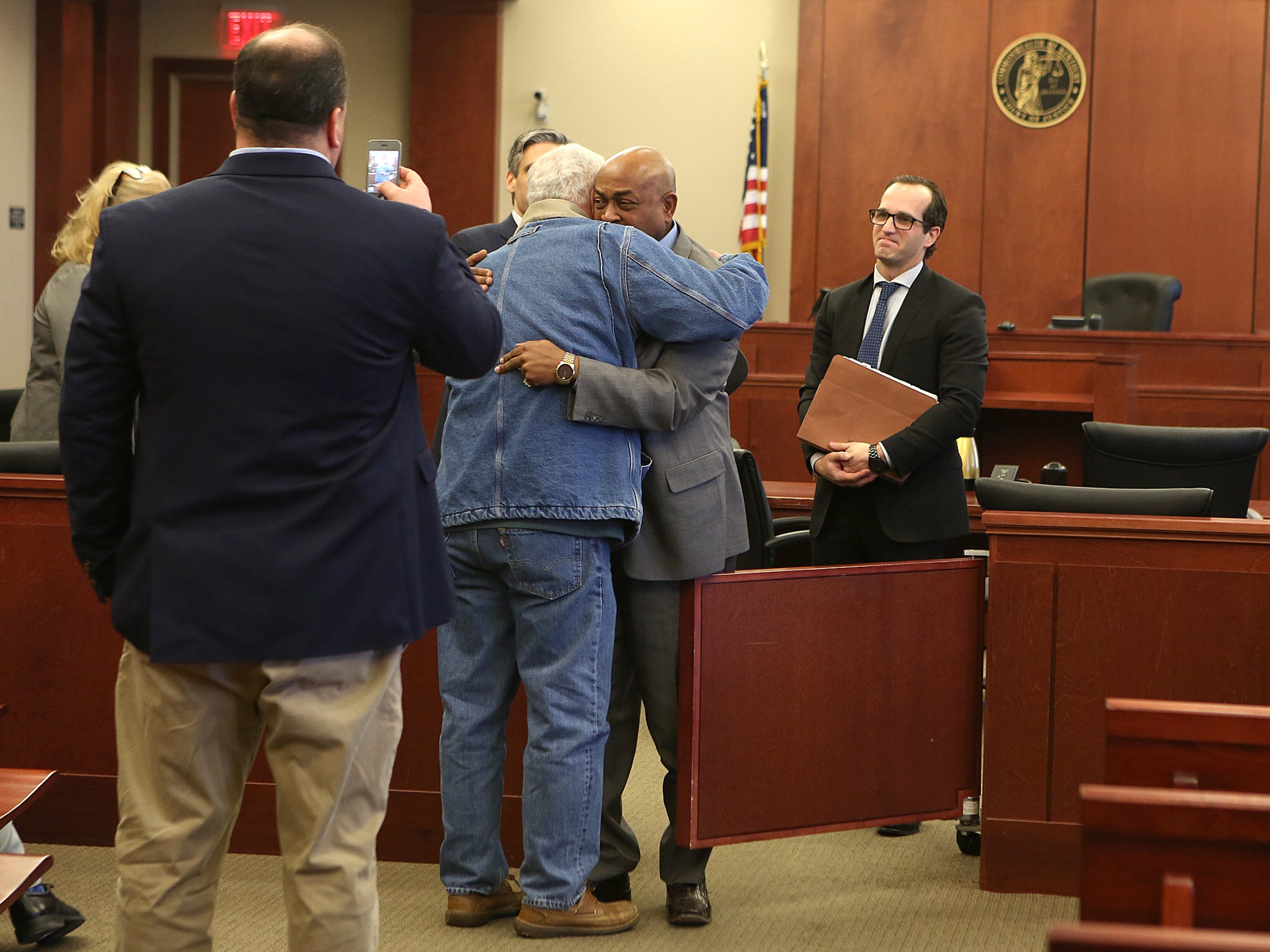 William Virgil, center, hugs a friend after learning that charges were being dismissed against him in the Retha Welch murder case. Welch was killed in April 1987. Virgil, convicted in 1988 for the crime, served 28 years before DNA testing overturned his conviction. The Enquirer/Amanda Rossmann