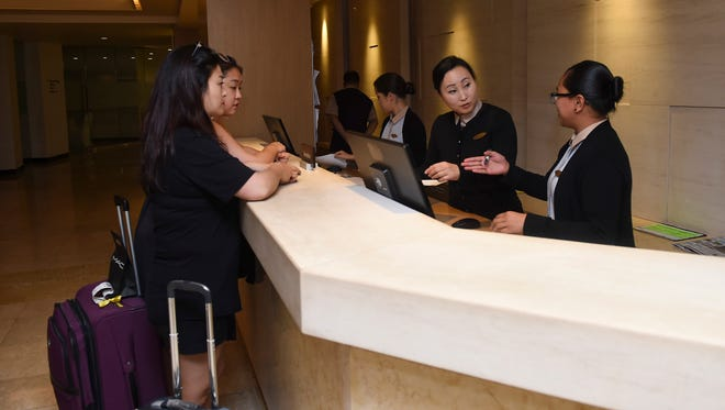 Tourists check-in at the Lotte Hotel Guam front desk in Tumon on Sept. 8, 2017.
