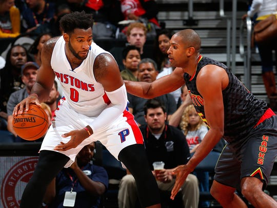 Atlanta's Al Horford defends against Pistons center Andre Drummond.