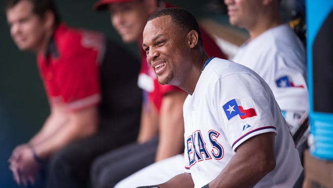 Rangers third baseman Adrian Beltre celebrates in the dugout after hitting his 400th career home run.