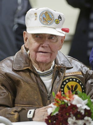 "Pearl Harbor survivor Stuart ""Bud"" Sweeny, 93, smiles during Pearl Harbor Remembrance observances at Ladewig-Zinkgraf American Legion Post 243 Monday in Plymouth."