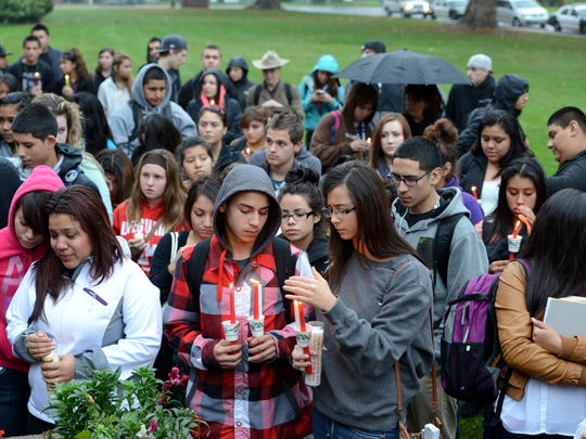 Students gather at North Salem High School for a candlelight vigil to honor Marisol Quesada.