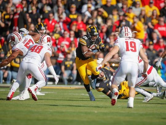 Iowa running back Akrum Wadley runs the ball against