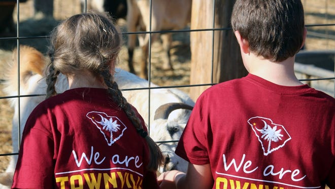 Townville Elementary School students feeds goats Thursday at Denver Downs Farm near Anderson.