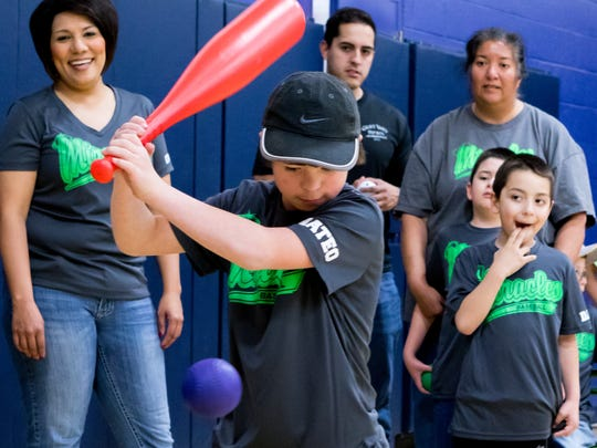 Mateo gets ready to take a swing while teammates and coaches look on at the Dream League baseball game event held Saturday at the Meersheidt Recreation Center.