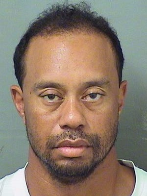 Tiger Woods had to be woken up by an officer after his Mercedes was found stopped on a Florida road.