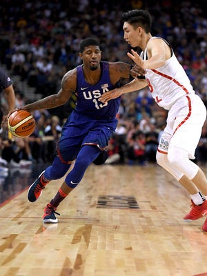 OAKLAND, CA - JULY 26:  Paul George #13 of the United States Men's National Team looks to drive past Ding Yanyuhang #8 of the China Men's National Team during the first half of a USA Basketball showcase exhibition game at ORACLE Arena on July 26, 2016 in Oakland, California.