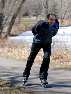 """Author and Blue Zones Project founder Dan Buettner skates around Lake of the Isles on April 14, 2008, near his home in Minneapolis. In his book """"The Blue Zones"""", Buettner identified place where people live healthy into their 90s and 100s. He spent seven years researching and traveling to the four """"Blue Zones"""" and reveals their common characteristics and how readers can add healthy years to their own lives."""