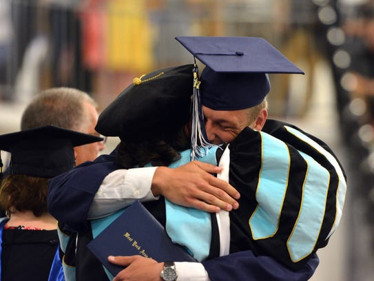 Kenton Meckley gets a hug from West York High School