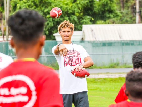 Maryland wide receiver Jeshaun Jones of South Fort Myers works with campers at the receiver station.