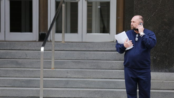 Arthur Rathburn of Grosse Pointe Park waits outside the federal courthouse in downtown Detroit after being released on bond Tuesday, Feb.  2, 2016.