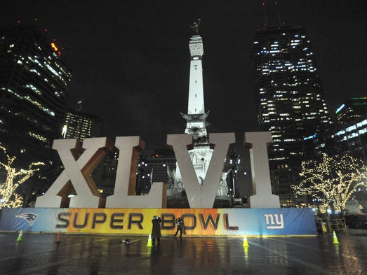 People ignored the cold and rain to come down to Monument Circle to see the Super Bowl XLVI letters set up in front of the Soldiers and Sailors Monument, Wednesday January 25, 2012. Joe Vitti / The Star