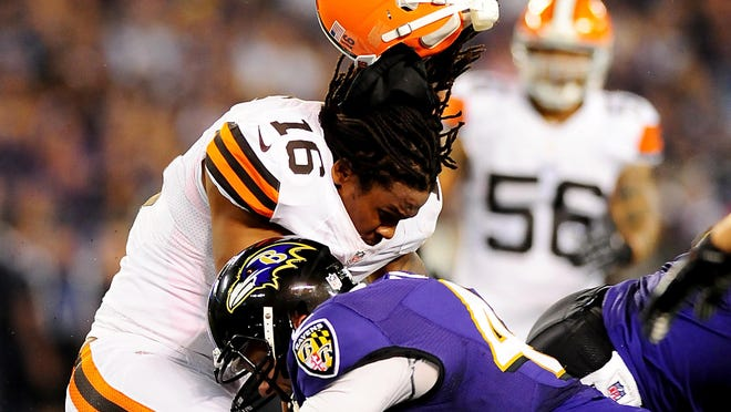 Cleveland Browns wide receiver Josh Cribbs (16) gets his helmet knocked off by Baltimore Ravens long snapper Morgan Cox (46) at M&T Bank Stadium in 2012.