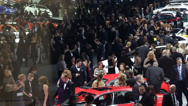 Crowds of people fill the aisles during the 2015 Charity Preview during the North American International  Auto Show at Cobo Center in Detroit on Jan. 16, 2015.